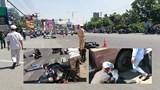Hàng chục người nâng xe khách cứu 2 nạn nhân trong gầm