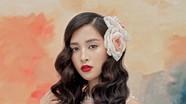 Hoa hậu Tiểu Vy gây bất ngờ với kiểu đầm hở bạo
