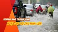 Đường phố thành Vinh ngập cục bộ sau mưa lớn