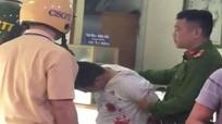 Bắt nghi phạm dùng súng cướp tiệm vàng