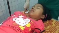 Bắt hai nghi can bịt mặt đâm dao găm vào tay bé 12 tuổi
