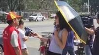 Phóng viên bị đình chỉ vì che ô, đeo kính râm đưa tin về bão