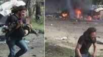 Nhà báo quỳ khóc nức nở bên xác em bé chết vì bom