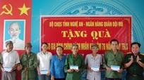 Bộ CHQS tỉnh tu bổ Nghĩa trang Liệt sỹ và tặng quà gia đình chính sách tại Nghi Lộc