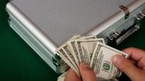 Bộ Tài chính Mỹ nghi ngờ Nga thao túng đồng USD