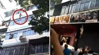 Hai đứa trẻ thoát chết nhờ mẹ ném qua cửa sổ căn hộ bốc cháy