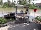 Thi thể nữ lái đò nổi trên sông, đầu và mặt có vết chém