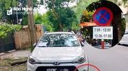 Nhiều ô tô bị xích vì dừng, đậu trái phép ở thành phố Vinh