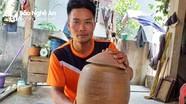 Đào móng nhà phát hiện hũ tiền cổ 36 kg ở Nghệ An