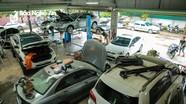 Ô tô, xe máy ở thành phố Vinh xếp hàng vào gara sau ngập lụt