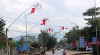 Người dân Nghệ An dựng cây nêu đón Tết