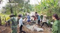 Hàng nghìn người dân san rừng làm đường nội bản